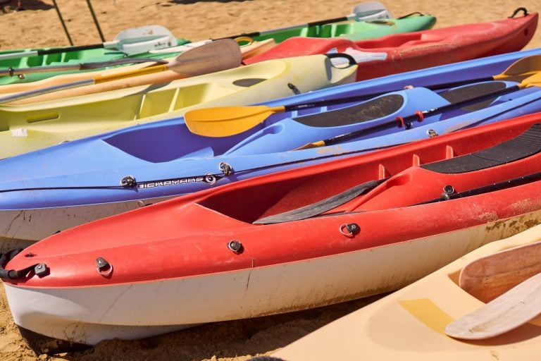 Assorted Kayaks on the Beach