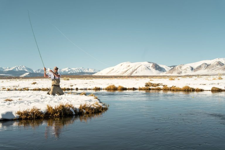 Man Fishing in the Winter
