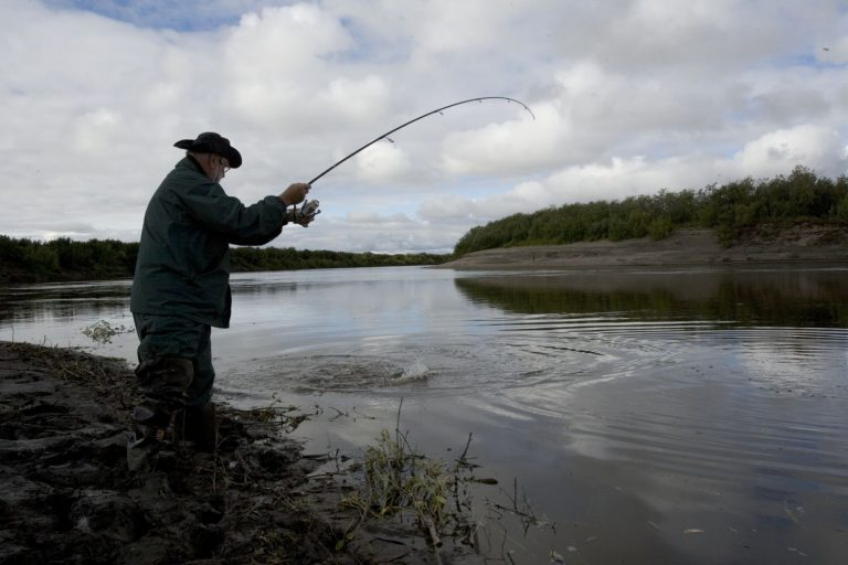 Fisherman Pulling a Potential Catch