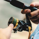 Close up Photo of a Fisherman Using a Spinning Reel