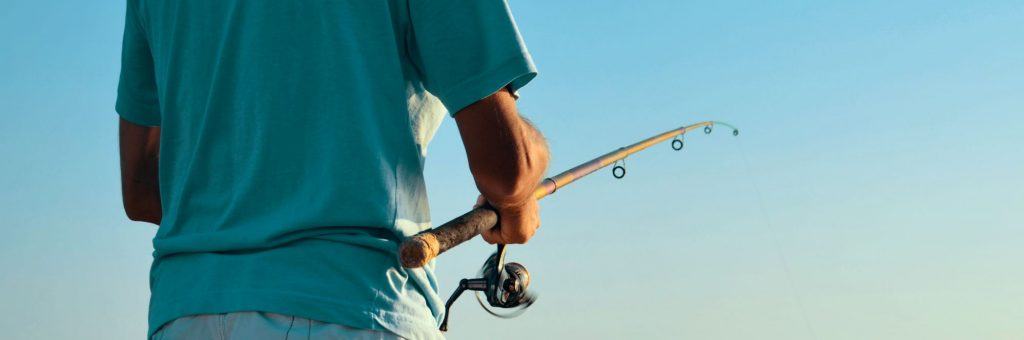 Man Fishing with a Spinning Reel