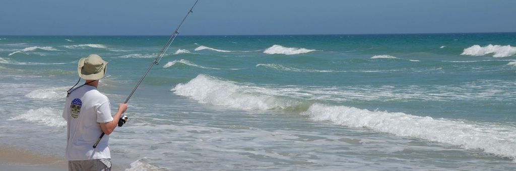 Man Surf Fishing at the Beach
