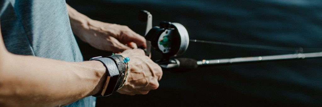 Person Using Casting Reel