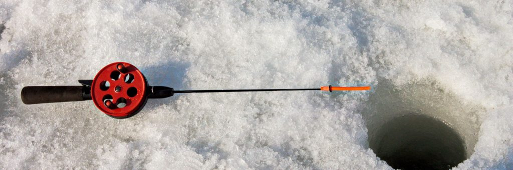Ice Fishing Rod on Top of Snow