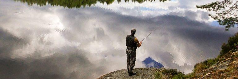 Man Fishing at a Lake