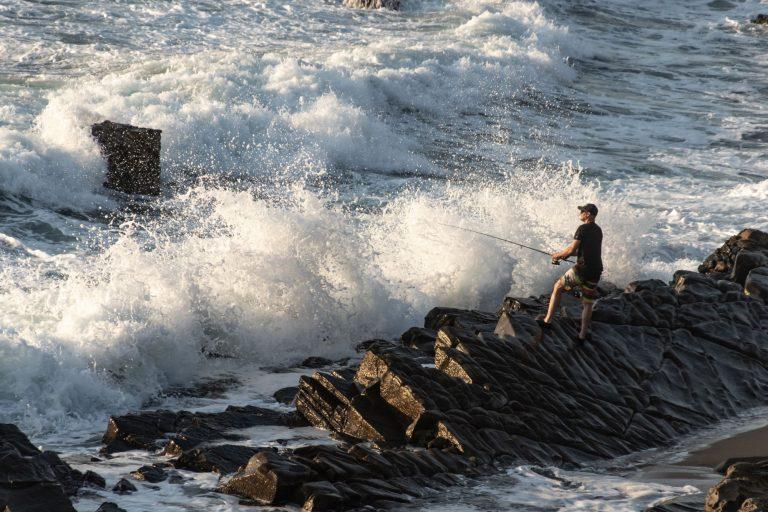 Man Surf Fishing at a Coast