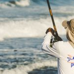 Person Fishing at a Shore