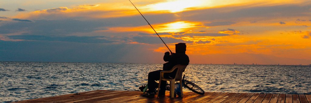 Man Fishing on a Dock Featured Image