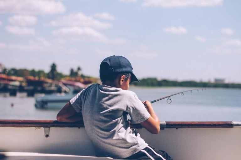 Child Fishing on a Boat