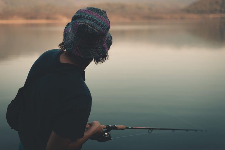 Young Man Fishing at a Lake