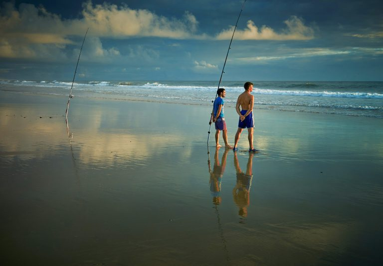 Two Men Fishing at the Beach