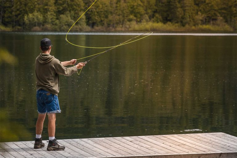 Man Fly Fishing on a Dock