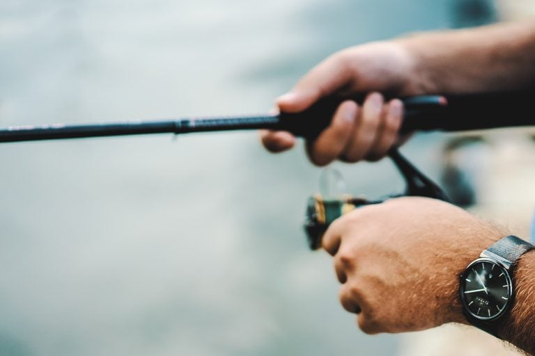Man Holding a Fishing Rod