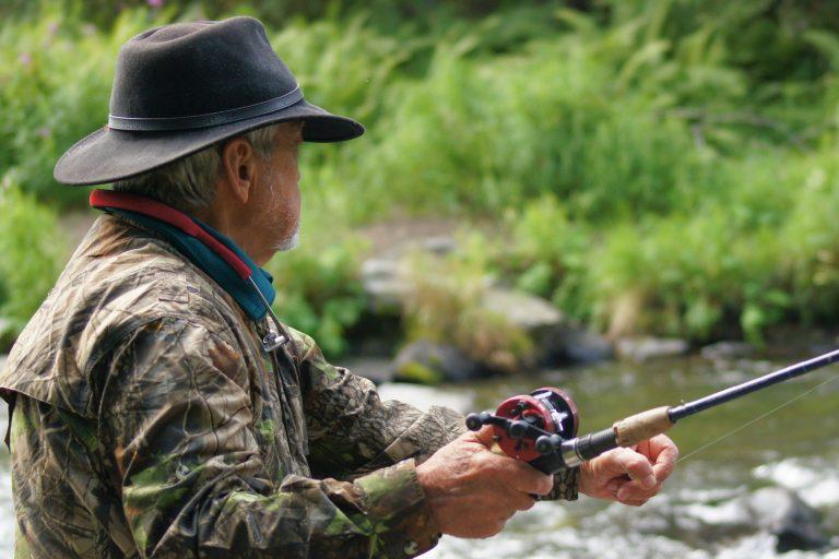 Man Fishing at a River
