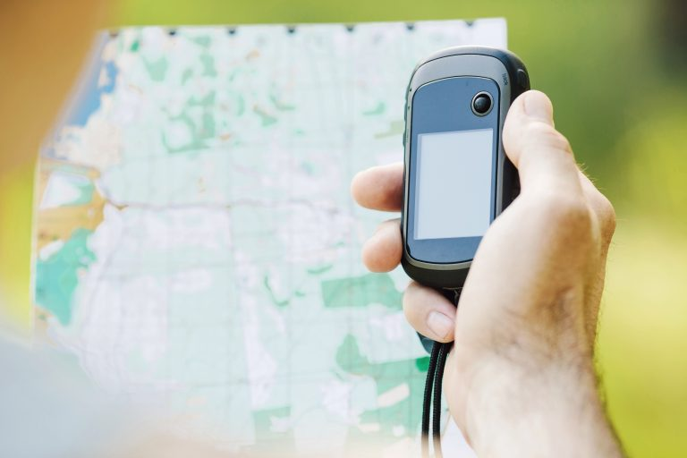 Person Holding a GPS Device