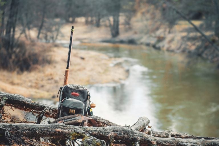 Fishing Backpack on Top of Logs