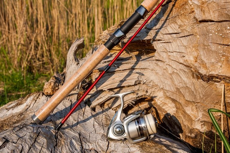 Fly Rod Placed on Wood