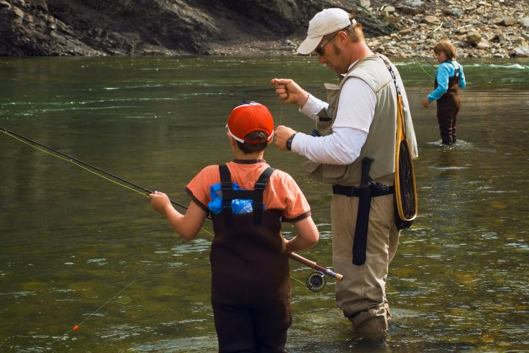 Man Teaching Child to Fish
