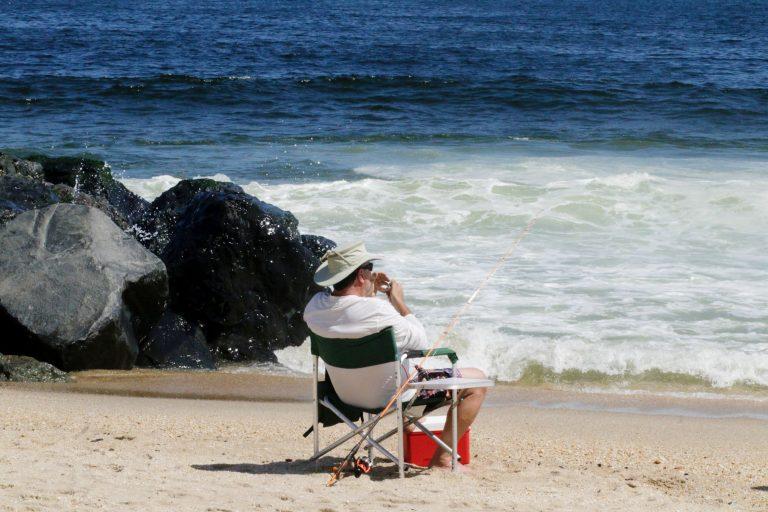 Fisherman Sitting at a Beach