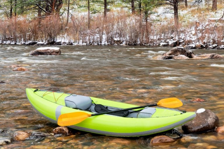 Green Inflatable Kayak on a River