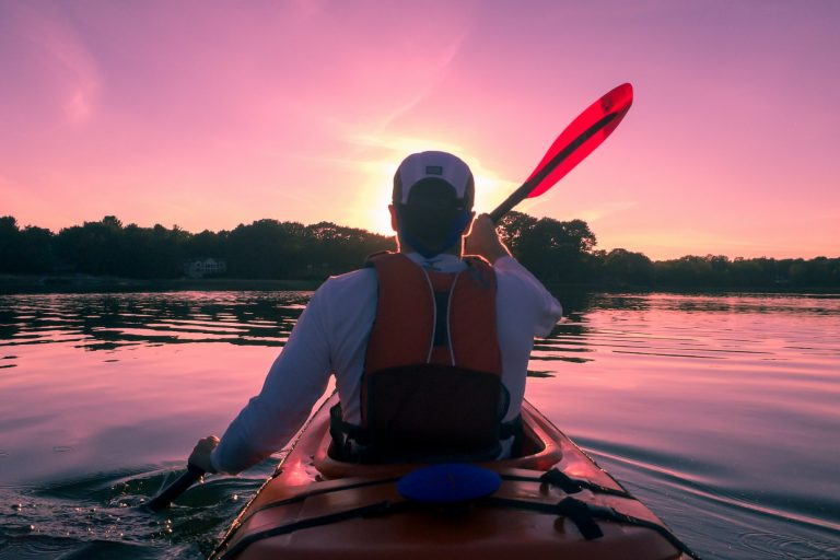 Man Sitting In the Front Part of a Kayak