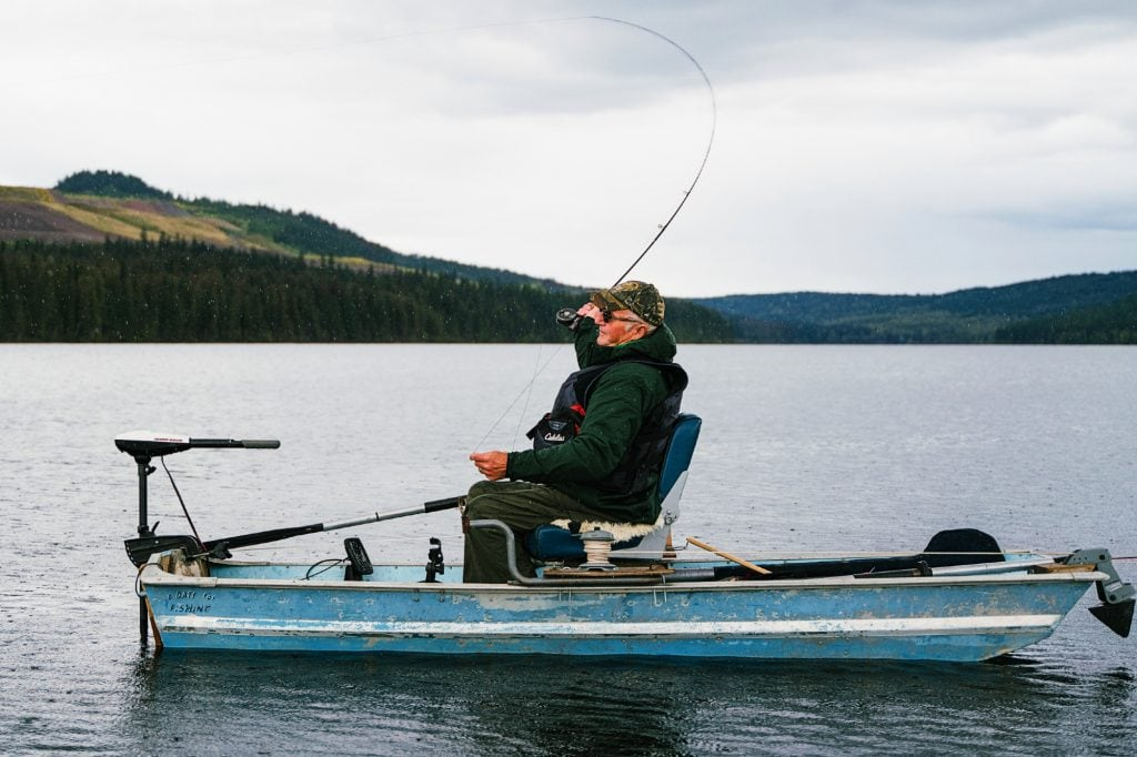 Man on a Boat Fishing on a Lake