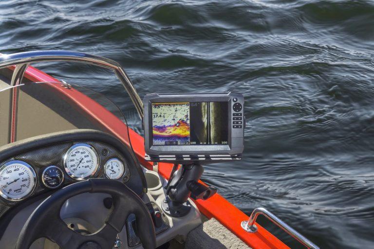 Fishfinder Near Boat Steering Wheel