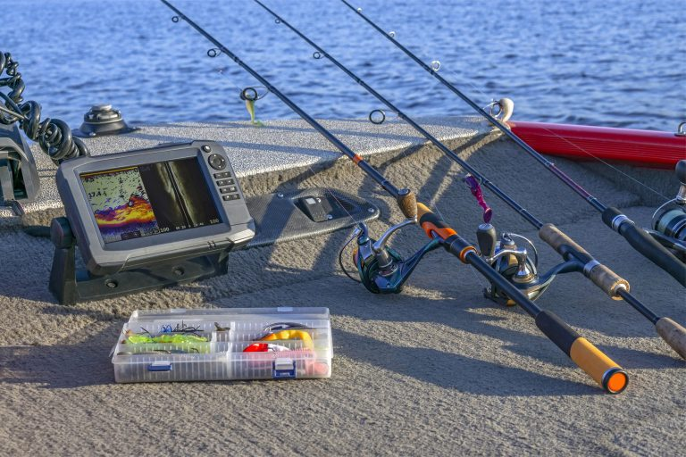 Fishfinder, Rods, and Tools at the Back of a Boat