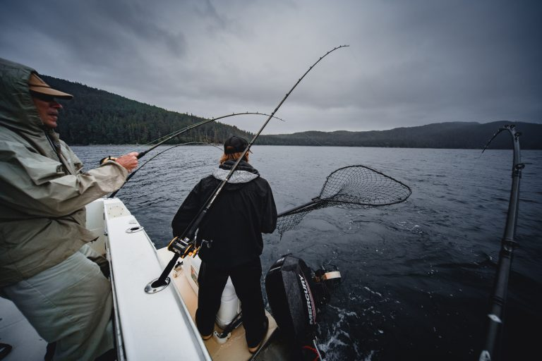 Man Preparing To Catch A Fish with a Net