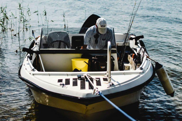 Man Sitting in a Docked Boat