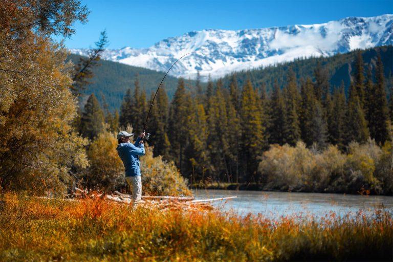 Man Fishing at a Mountain River