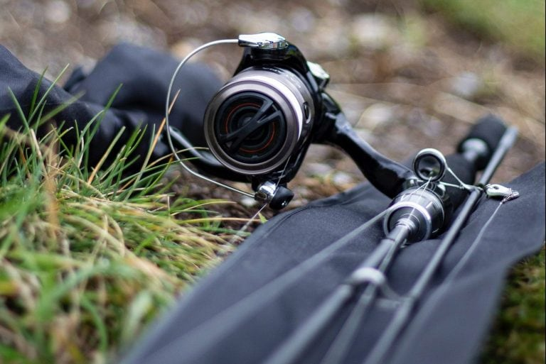 A close-up of a fishing rod and reel's parts