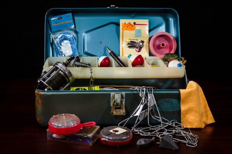 A tackle box with a plethora of fishing gear