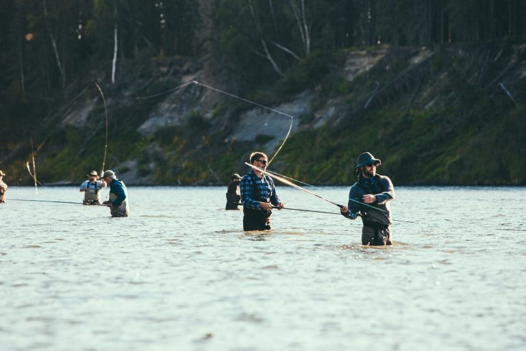 Multiple fly fishers in a river